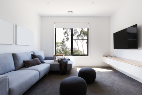 Flatscreen TV mounted in clean white modern apartment